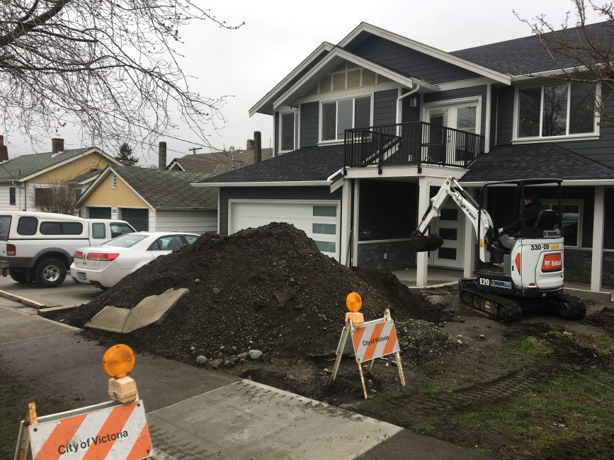 Removing large dirt pile prior to prepping front lawn for sod installation Victoria, BC.
