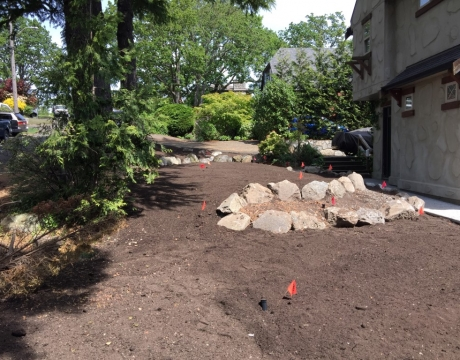 Concrete Walkway, Patio, New Lawn and Boulder Garden Beds.