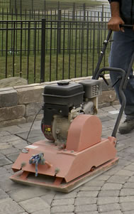 Compacting Polymeric Sand Before Watering